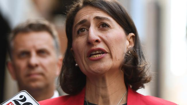 Premier Gladys Berejiklian (front) and Minister for Transport and Infrastructure, Andrew Constance (left) are under pressure to get the light rail open before the next state election in 2019. Picture: Dean Lewins/AAP