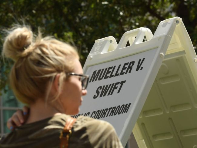 Mueller vs Swift. Photo: RJ Sangosti/The Denver Post via Getty Images.