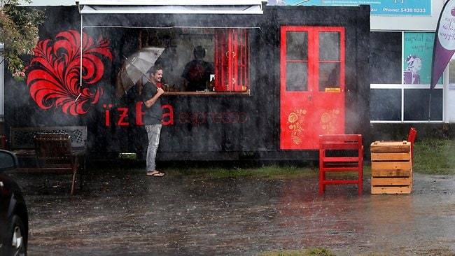 RAIN: IZBA coffee stop opens on a wet day at Currimundi. Picture: Glenn Barnes