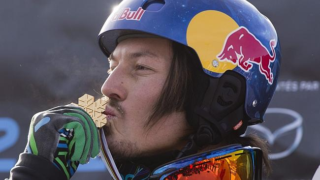 Here, Pullin kisses his gold medal after winning the men's snowboard cross final at the Snowboard World Championships last ye...