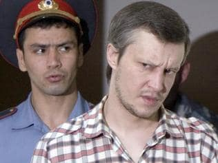 "Alexander Pichushkin, the Bitsevsky Maniac, is escorted into the courtroom of the Moscow City Court in Moscow, 13 Aug 2007. Pichushkin, 33yrs, appeared at the start of a long-awaited trial in the so-called ""Bitsevsky maniac"" case, referring to a sprawling park on Moscow's southern edge where he supposedly bludgeoned his victims with a hammer and then disposed of their bodies. Pichushkin is being tried for 49 murders, although the chief investigator said there was proof he had killed 62 people. AFP PicKostya/Smirnov headshot crime o/seas russia murder serial killer"