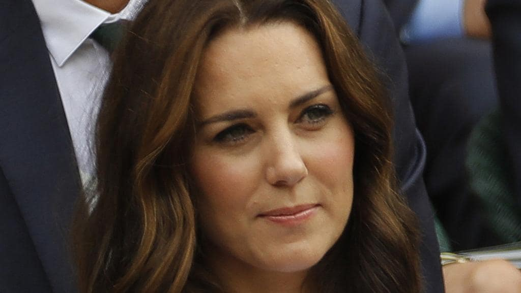 Kate Middleton has captured the spirit of Wimbledon in a summery white dress, with a vibrant floral print. Picture: AP.