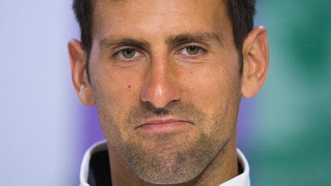 Serbia's Novak Djokovic speaks during a press conference at The All England Tennis Club in Wimbledon, southwest London, on July 12, 2017, after retiring from his men's singles quarter-final match against Czech Republic's Tomas Berdych on the ninth day of the 2017 Wimbledon Championships. Berdych won the match 7-6, 2-0. Djokovic retired in the second set. Novak Djokovic said a right elbow injury was to blame for his retirement from Wednesday's Wimbledon quarter-final against Tomas Berdych. / AFP PHOTO / POOL / AELTC AND AELTC/Joe Toth / Joe TOTH