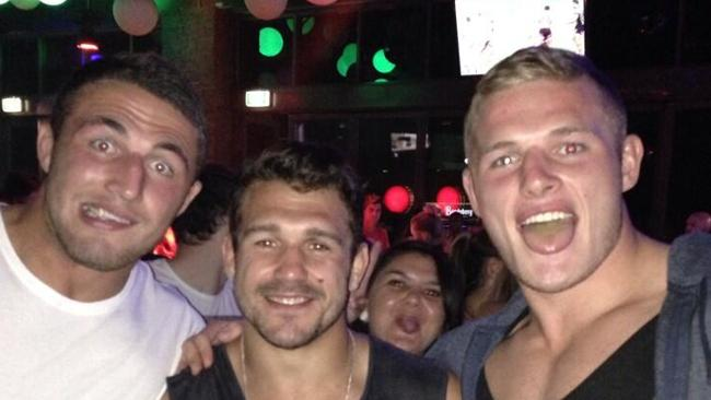 Sam Burgess, Cowboys player Scott Moore and George Burgess at Gilligans in Cairns.