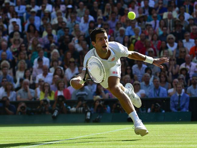 Novak Djokovic at full stretch on his way to the Wimbledon title.