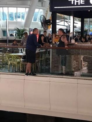 Gregory Butler can be seen on the ledge at Bali airport. Picture: Supplied