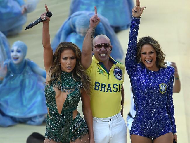US rapper Pitbull (C) Brazilian pop singer Claudia Leitte (R) and US singer Jennifer Lopez (L) salute the audience as they take part in the opening ceremony of the 2014 FIFA World Cup.