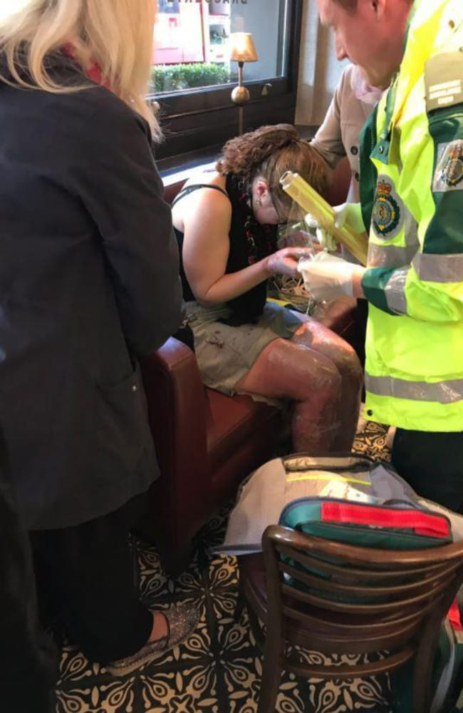 A woman injured in the blast is treated by paramedics