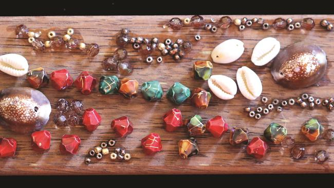 Lynne Kelly's memory board in the style of the Luba lukasa, made from wood, beads and shells.