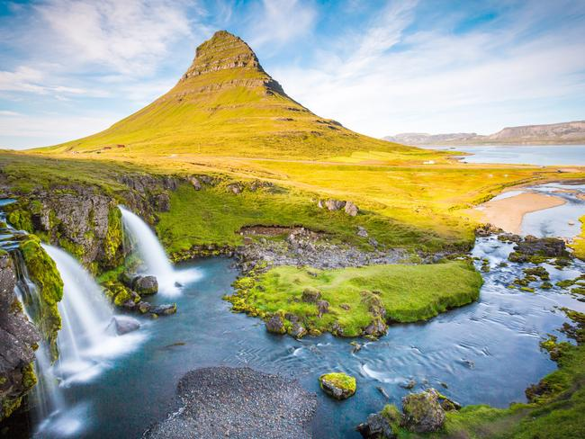 ESCAPE 12NOV17 BEST TOURING - Jet Setters. Kirkjufell Mountain, Iceland, Landscape with waterfalls, long exposure in a sunny day, Snaefellsnes peninsula. Picture: Supplied/ BlackTomato