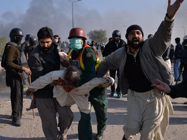An injured activist is carried away from clashes with police. Picture: AFP