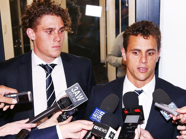 Charlie and Ed Curnow speak to media after their AFL Tribunal Hearing into intentional contact with an umpire. (Photo by Michael Dodge/Getty Images)
