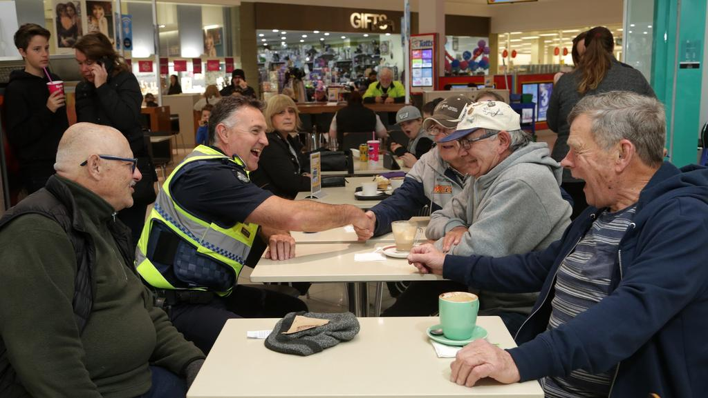 Senior Sergeant Steve Wood meet with locals as part of 'Coffee with a Cop' at Rosebud Plaza. Picture: Hamish Blair