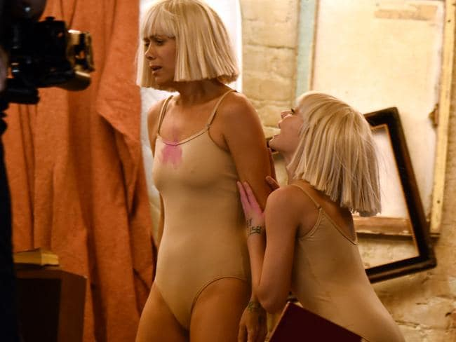 Now you Sia, now you don't ... actor Kristen Wiig — in a wig — and dancer Maddie Ziegler perform Chandelier. Picture: Larry Busacca/Getty Images for NARAS