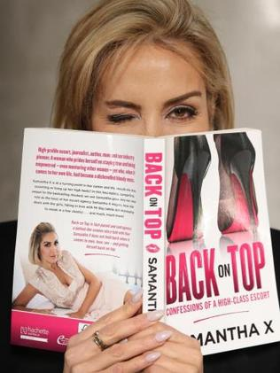 High class escort Samantha X pictured with her latest book 'Back on Top — Confessions of a high-class escort'. Picture: Toby ZernaSource:News Corp Australia
