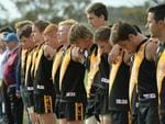 Players observe a minute's silence ahead of the match. Picture Mark Brake