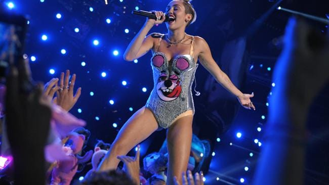 Miley Cyrus began her performance in this skimpy number and then stripped down to laytex underwear. Picture:AP Photo/MTV, John Shearer