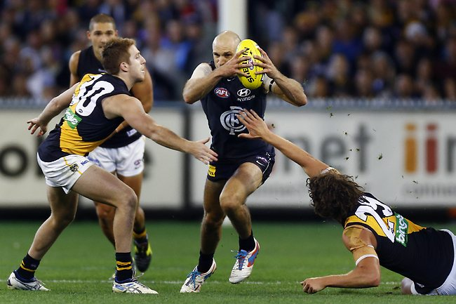 Chris Judd breaks through the tacklers during third quarter. Picture: Klein Michael