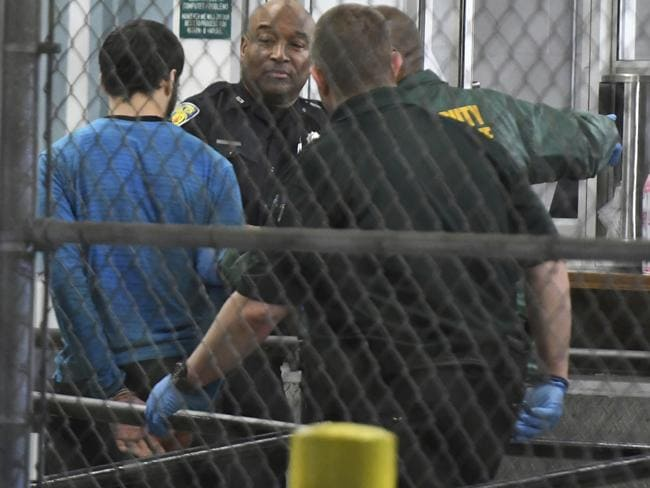 Esteban Santiago, 26, the suspect in the deadly shooting at Fort Lauderdale-Hollywood International Airport, is transported to the Broward County Main Jail. Picture: Jim Rassol/South Florida Sun-Sentinel via AP