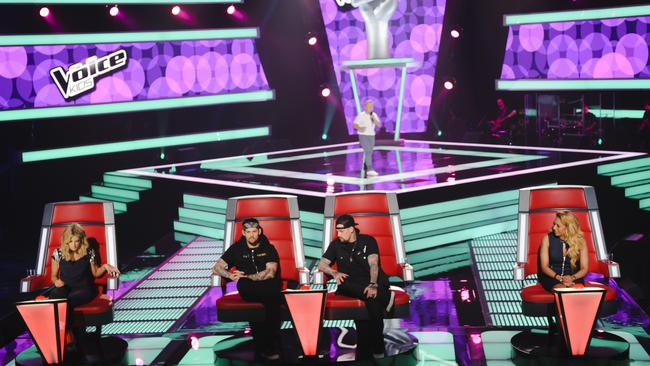 Voice Kids contestant Robbie hits the stage during the blind auditions.