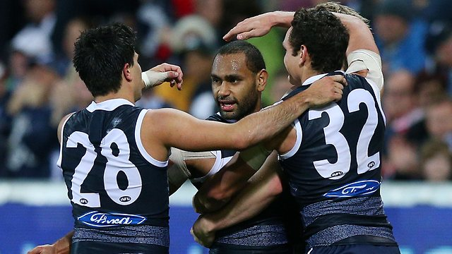 Cats ... Travis Varcoe is congratulated by teammates.