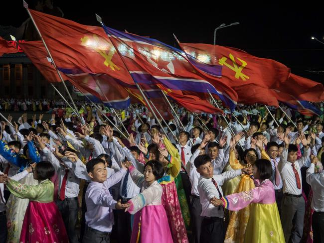 North Koreans perform during an event marking the 20th anniversary of late North Korean leader Kim Jong Il's election. Picture: AFP/ Kim Won-Jin