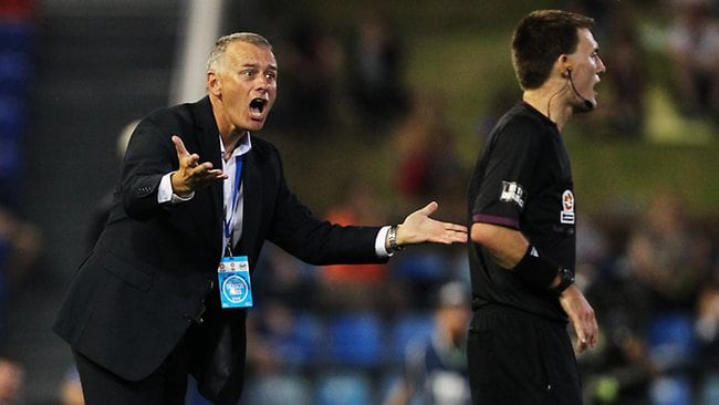 Gary Van Egmond berates an A-League assistant referee. Picture: Liam Driver