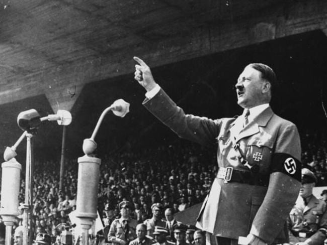 Ticket to Reich ... German Chancellor Adolf Hitler gestures during a speech in May 1937.