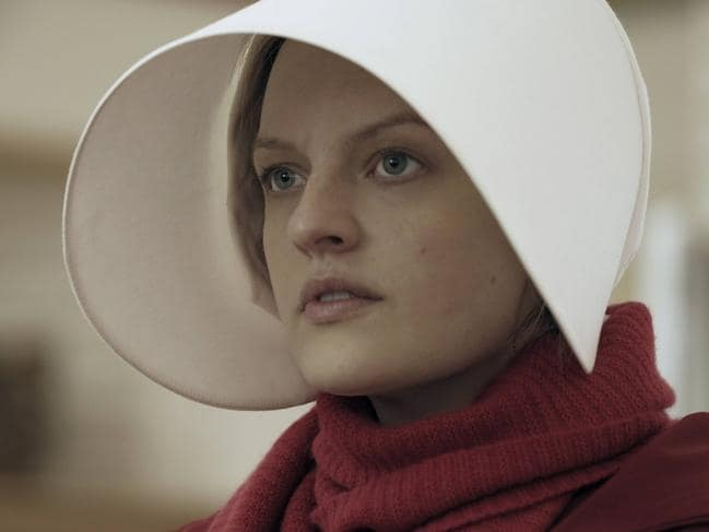 "This image released by Hulu shows Elisabeth Moss as Offred in a scene from, ""The Handmaid's Tale."" Moss was nominated for an Emmy Award for outstanding lead actress in a drama series on Thursday, July 13, 2017. The Emmy Awards ceremony, airing Sept. 17 on CBS, will be hosted by Stephen Colbert. (George Kraychyk/Hulu via AP)"