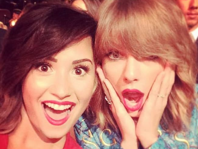 Too much fun ... Demi Lovato and Taylor Swift at the VMAs.