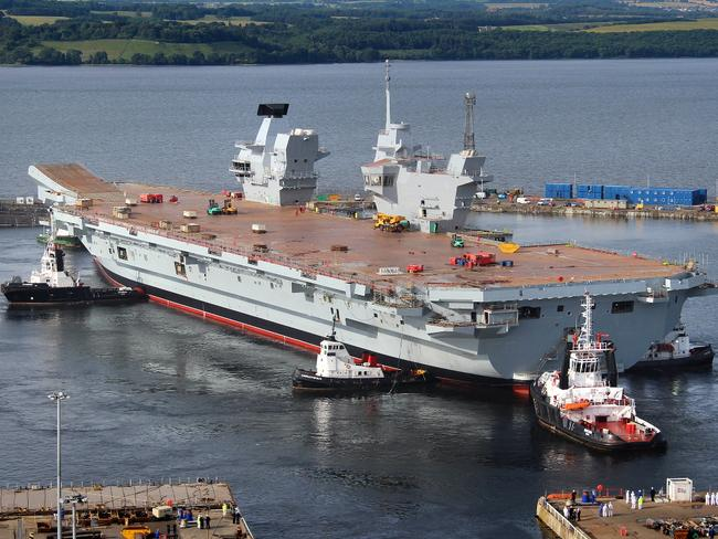 Empty promise ... The Royal Navy's largest ever warship HMS Queen Elizabeth is gently floated out of her dock in Rosyth, Scotland. The ship has no aircraft. Source: Wikipedia