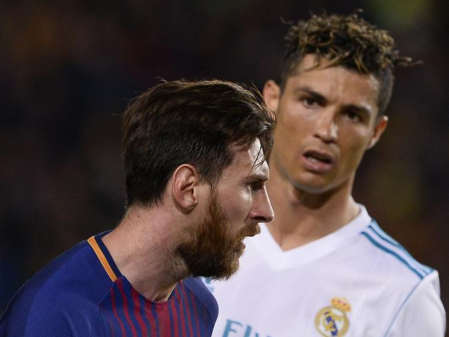 Real Madrid's Cristiano Ronaldo looks at Barcelona's Lionel Messi. The pair have been featured in a threat from ISIS ahead of the World Cup. Picture: AFP/Josep Lago