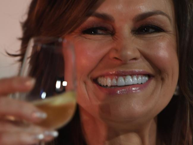Former Today host Lisa Wilkinson enjoys a glass of champagne during the Moet and Chandon Guinness Book of Records tasting attempt in Sydney, Friday, October, 20, 2017. (AAP Image/Dean Lewins) NO ARCHIVING