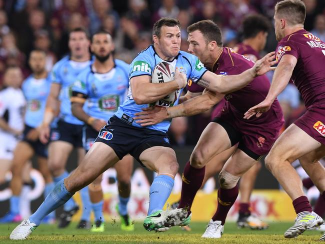 Brett Morris charges the ball up for the NSW Blues against Queensland last week. Picture: AAP