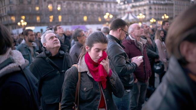 The world weeps for Belgium. People gathering in Paris to pay tribute to the victims of the Brussels attacks. Picture: Martin Bureau / AFP