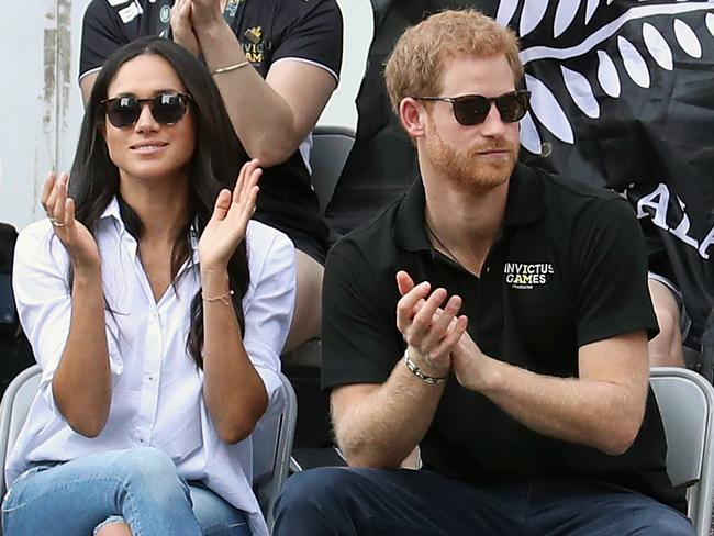 Prince Harry and Meghan Markle watch a wheelchair tennis match. Picture: Chris Jackson/Getty Images for the Invictus Games Foundation