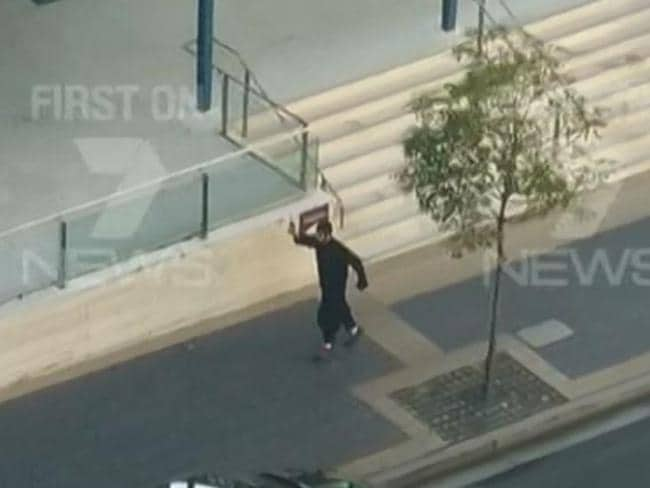 Channel 7 video frame grabs of the moment Parramatta shooter 15-year-old Farhad Khalil Mohammad Jabar started firing a gun in front of Parramatta police station.