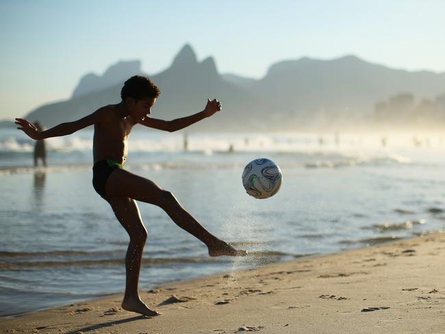 The World Cup in Brazil is worth more than $2 billion to each of the major sporting brands. Pictured, a boy plays football in Rio. Pic: Julian Finney, Getty.