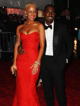 Better days ... West with ex, Amber Rose. Picture: Stephen Lovekin/Getty Images