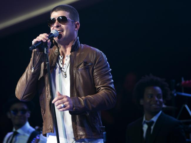 Robin Thicke performs on stage during the annual Wal-Mart Shareholders meeting.