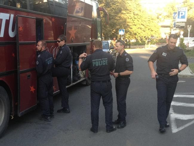 Test of nerve ... Australian Federal Police prepare to leave Donetsk on Friday morning. Picture: Paul Toohey
