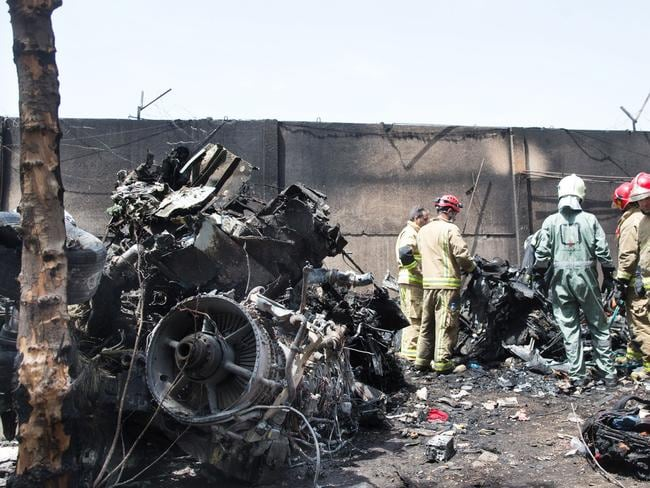 Wreckage ... The plane triggered a fireball when it smashed into the ground. Picture: Rouhollah Vahdati
