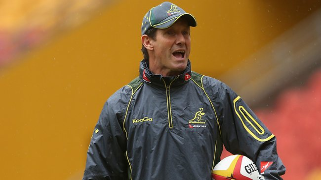 Robbie Deans, coach of the Wallabies talks to players during an Australian Wallabies Captain's Run at Suncorp Stadium on June 21, 2013.