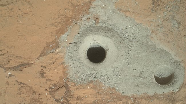 "At the center of this image from NASA's Curiosity rover is the hole in a rock called ""John Klein"" where the rover conducted its first sample drilling on Mars. (Pic: NASA/JPL-Caltech/MSSS)"