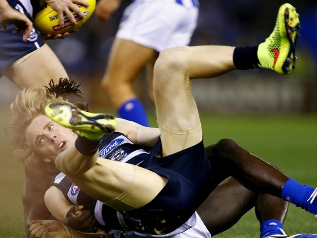 Geelong's Cameron Guthrie gets tackled by Majak Daw. Picture: Michael Klein