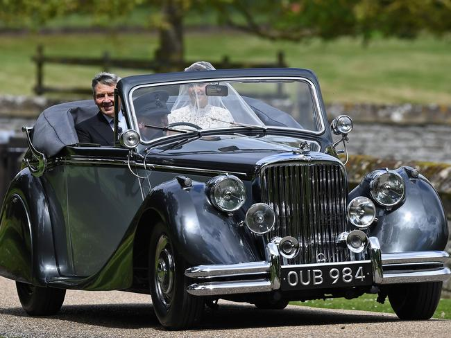 Pippa Middleton arrives with her father Michael Middleton in the vintage Jaguar.