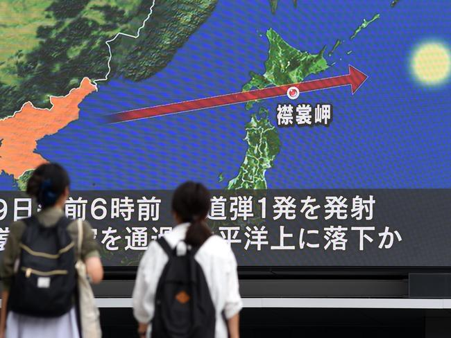 Pedestrians watch the news on a huge screen displaying a map of Japan and the Korean Peninsula following a North Korean missile test that passed over Japan. Picture: AFP