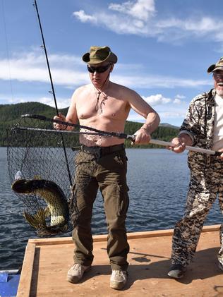 Vladimir Putin shows off his fishing skills. Picture: AP/Sputnick/Alexey Nikolsky