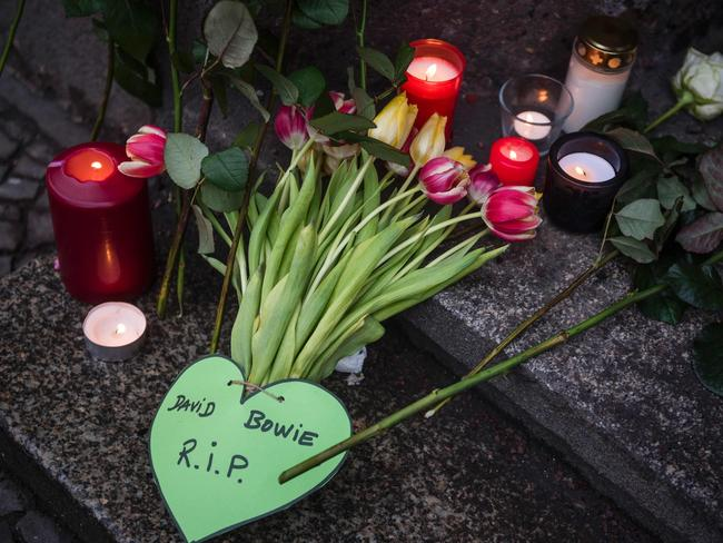 Tributes left ... for David Bowie outside his former home in Berlin's Hauptstrasse 155. Picture: AFP