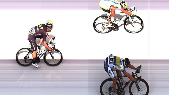 Australia's Simon Gerrans, bottom, crosses the finish line ahead of Peter Sagan of Slovakia, top and second place, and Jose Joaquin Rojas of Spain, left and third place, to win the third stage of the Tour de France cycling race.